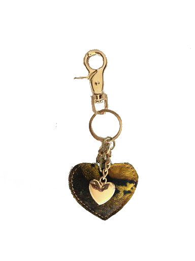 Leren-sleutelhanger-hartjes- geel zwarte dierenprint van koeienhuid-leder-gouden-sleutel-hangers gouden hartje-online-bestellen