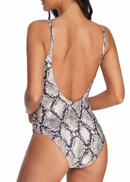 Badpak-Snake- nxt-lvl-badpakken dames laag uitgesneden zwart witte slangenprint musthave slang one piece kopen bestellen achter