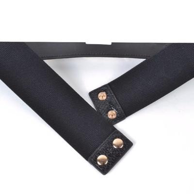 Elastische Riem Big Chain zwart zwarte riem van elastiek met gouden schakelketting detail dames riemen trendy drukknopen achter